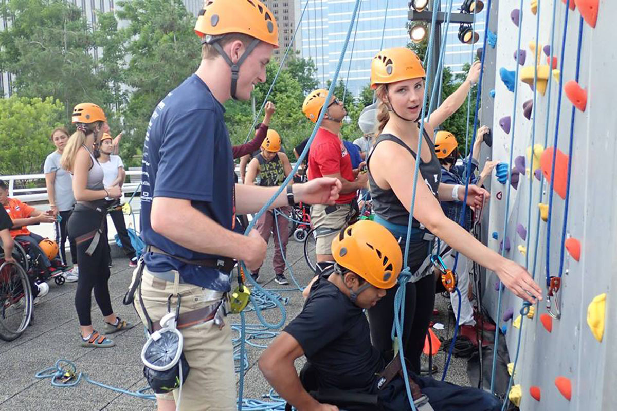 Regional Youth Wheelchair Basketball Program rock climbing in the city